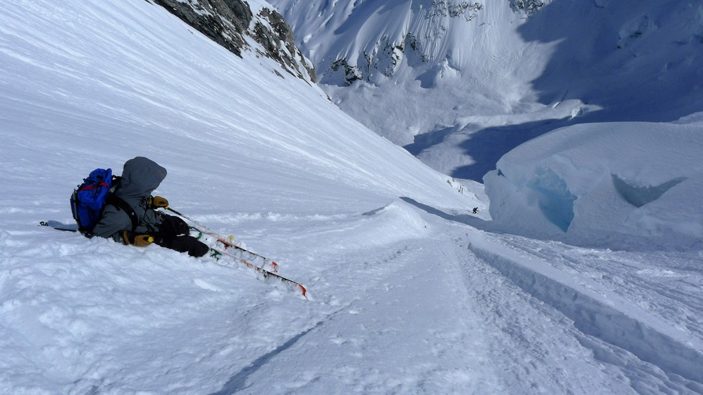 Mike taking a break about half way down while Simon skis onto a vulnerable section where we had to go below the seracs.
